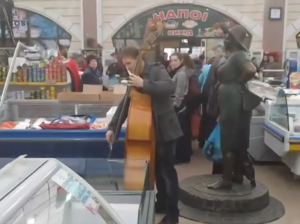 """A cellist performs the opening bars of Beethoven's """"Ode to Joy"""" at Privoz market in Odesa"""