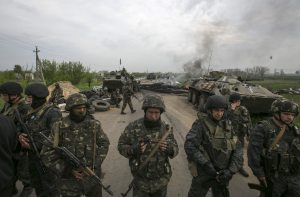 Ukrainian soldiers stand guard at aa Ukranian checkpoint near the eastern town of Slaviansk